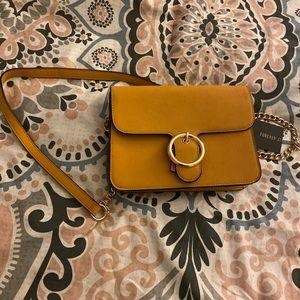 Stylish yellow suede purse